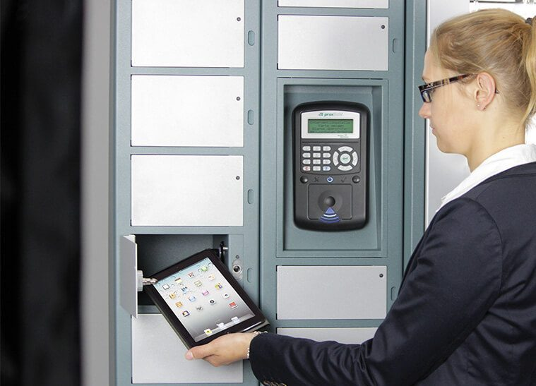Tablet being removed from electronic locker